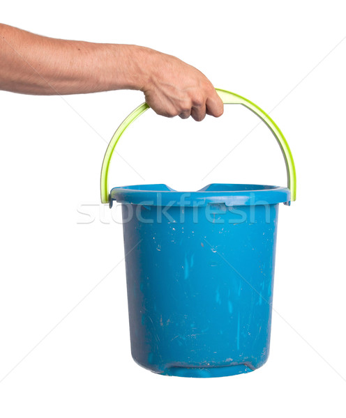 Human hand holding empty plastic pail Stock photo © michaklootwijk