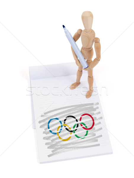 Wooden mannequin made a drawing - Olympic Rings Stock photo © michaklootwijk