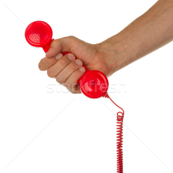Man holding a red telephone Stock photo © michaklootwijk