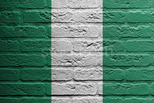 Parede de tijolos pintura bandeira Nigéria isolado pintar Foto stock © michaklootwijk