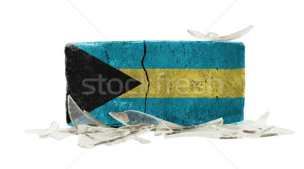 Baksteen gebroken glas geweld vlag Bahamas muur Stockfoto © michaklootwijk