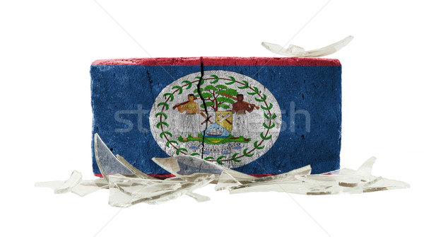 Mattone vetri rotti violenza bandiera Belize muro Foto d'archivio © michaklootwijk