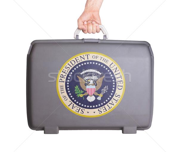 Folosit plastic valiză imprimate semna Imagine de stoc © michaklootwijk