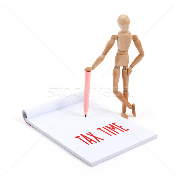 Wooden mannequin writing - Tax time Stock photo © michaklootwijk