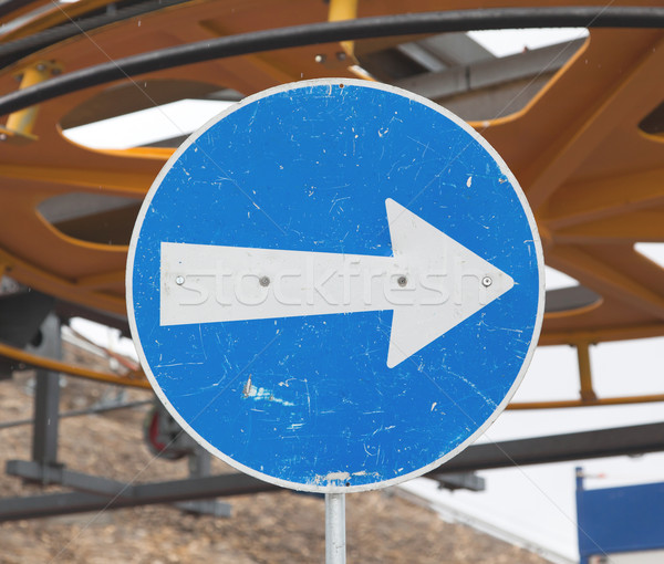 Blue road sign with white arrow pointing right Stock photo © michaklootwijk
