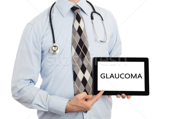 Doctor holding tablet - Glaucoma Stock photo © michaklootwijk
