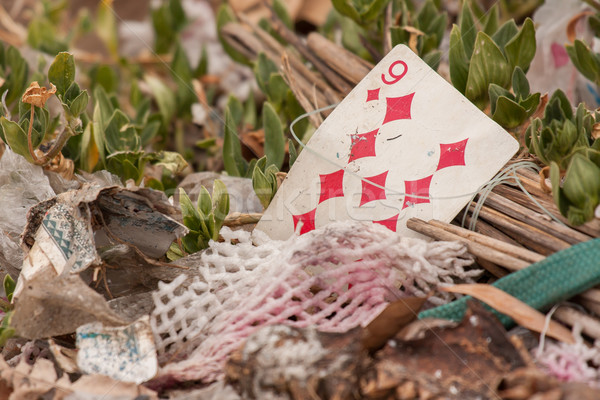Old playing card on a pile of garbage Stock photo © michaklootwijk