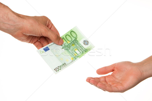 Man giving 100 euro to a woman Stock photo © michaklootwijk