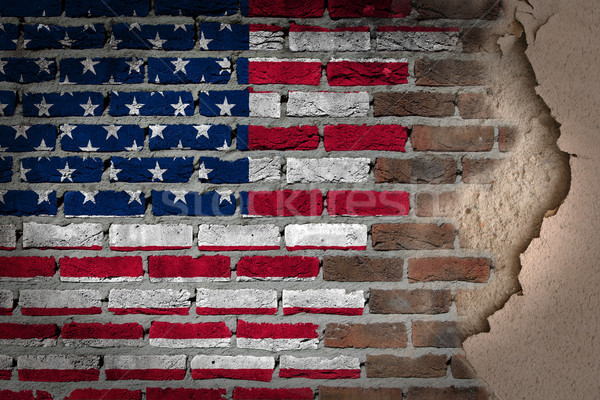 Dark brick wall with plaster - USA Stock photo © michaklootwijk
