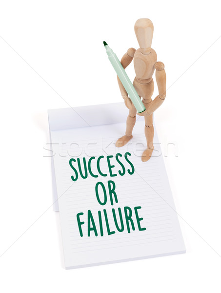 Wooden mannequin writing - Success or failure Stock photo © michaklootwijk