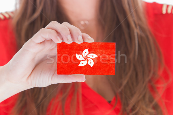 Woman showing a blank business card Stock photo © michaklootwijk