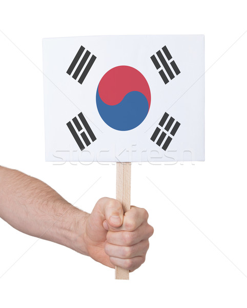 Hand holding small card - Flag of South Korea Stock photo © michaklootwijk