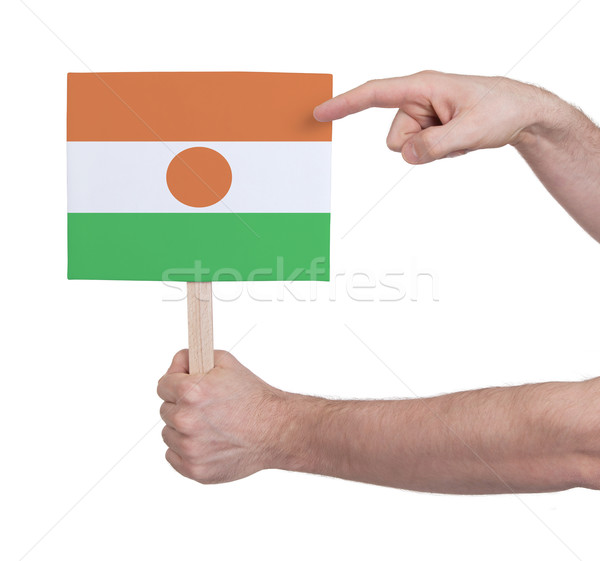 Hand holding small card - Flag of Niger Stock photo © michaklootwijk
