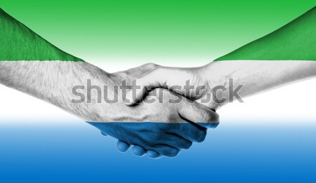 Aperto de mãos duas pessoas masculino feminino amarelo pele Foto stock © michaklootwijk