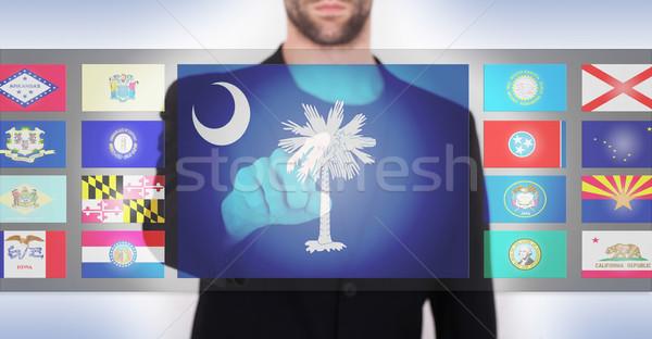 手 プッシング タッチスクリーン インターフェース サウスカロライナ州 ストックフォト © michaklootwijk