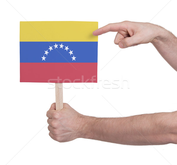 Hand holding small card - Flag of Venezuela Stock photo © michaklootwijk