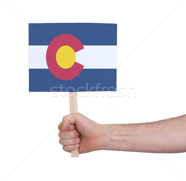 Kéz tart kicsi kártya zászló Colorado Stock fotó © michaklootwijk