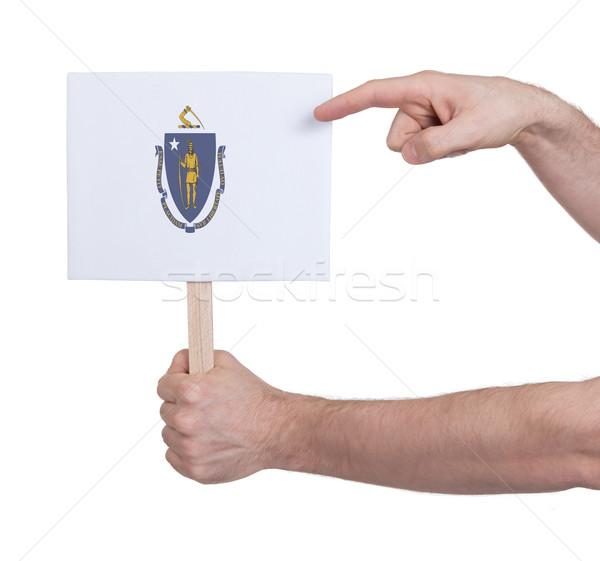 Hand holding small card - Flag of Massachusetts Stock photo © michaklootwijk