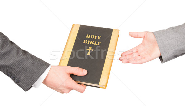 Man and woman in business suits are holding a holy bible Stock photo © michaklootwijk