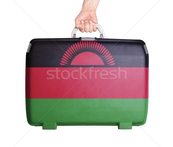 Kullanılmış plastik bavul basılı bayrak Stok fotoğraf © michaklootwijk
