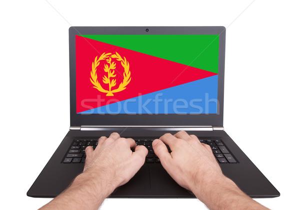 рук рабочих ноутбука Эритрея экране Сток-фото © michaklootwijk
