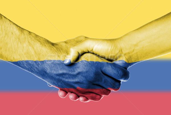 Man vrouw handen schudden vlag patroon Colombia Stockfoto © michaklootwijk