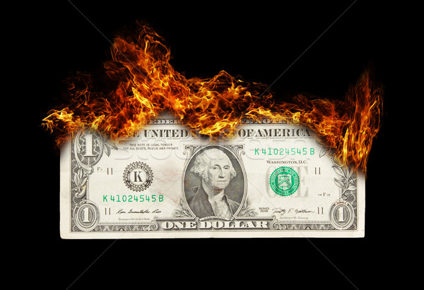 Burning dollar bill symbolizing careless money management Stock photo © michaklootwijk