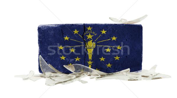 Mattone vetri rotti violenza bandiera Indiana muro Foto d'archivio © michaklootwijk