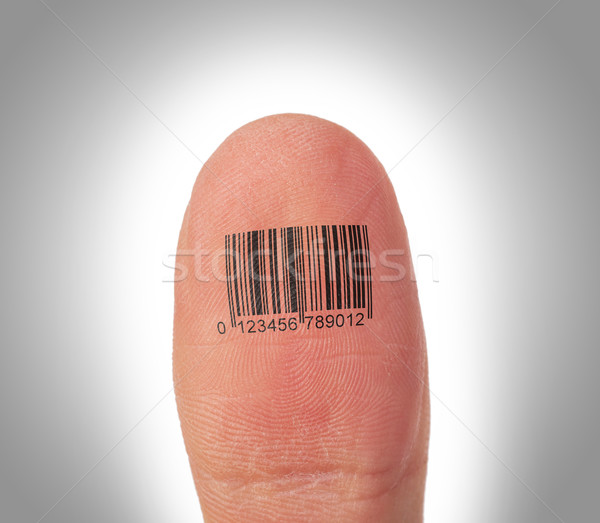 Thumb finger over a white background, barcode Stock photo © michaklootwijk