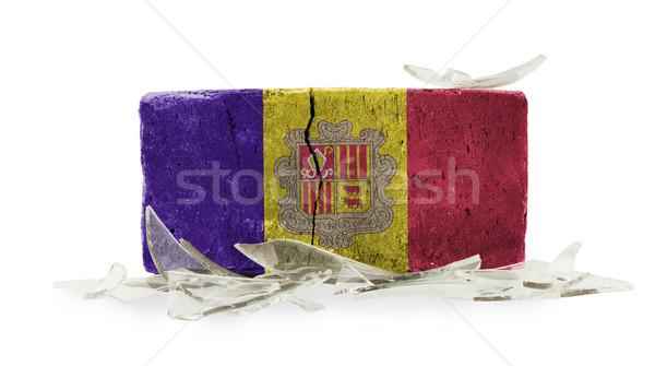 Mattone vetri rotti violenza bandiera Andorra muro Foto d'archivio © michaklootwijk
