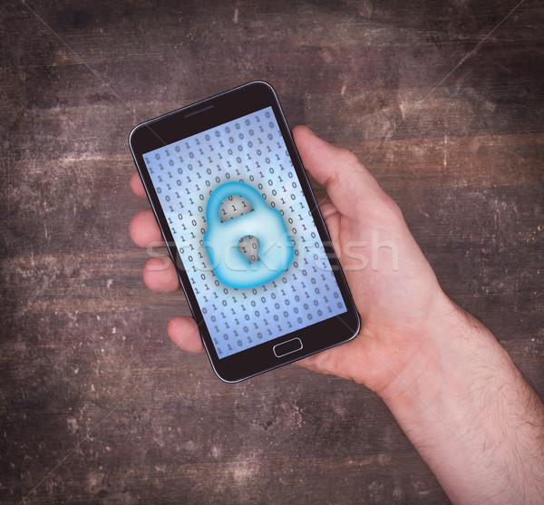 Photo stock: Smartphone · main · protection · des · données · bleu · ordinateur · technologie