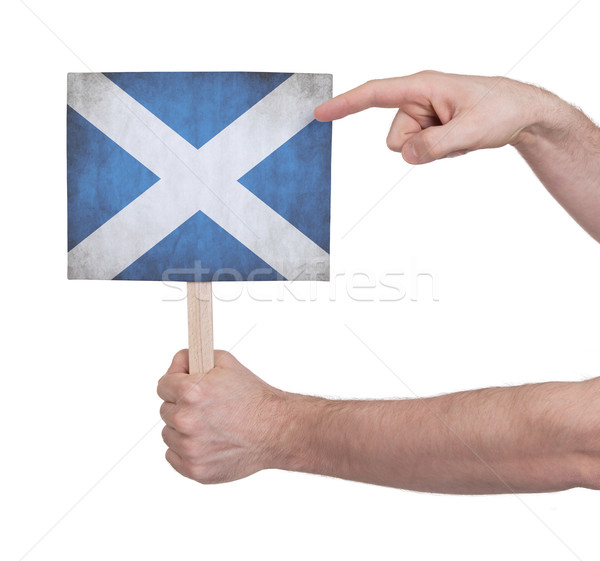 Hand holding small card - Flag of Scotland Stock photo © michaklootwijk