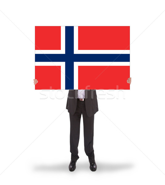 Smiling businessman holding a big card, flag of Norway Stock photo © michaklootwijk