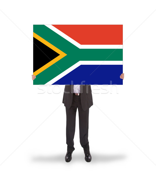 Smiling businessman holding a big card, flag of South Africa Stock photo © michaklootwijk