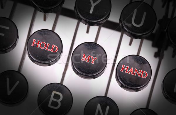 írógép különleges gombok tart enyém kéz Stock fotó © michaklootwijk