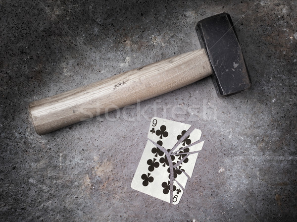 Hammer with a broken card, nine of clubs Stock photo © michaklootwijk