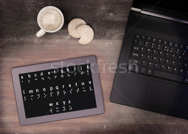 Braille on a tablet, concept of impossibility Stock photo © michaklootwijk