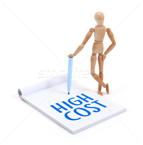 Wooden mannequin writing - High cost Stock photo © michaklootwijk