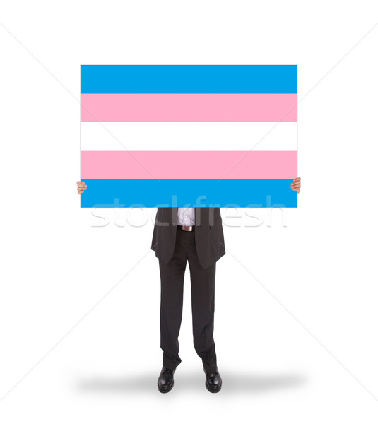 Smiling businessman holding a big card, flag of Trans Pride Stock photo © michaklootwijk
