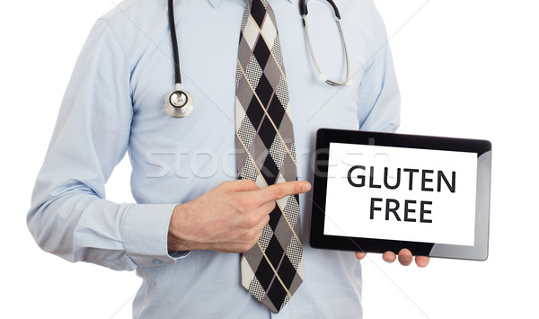 Doctor holding tablet - Gluten free Stock photo © michaklootwijk