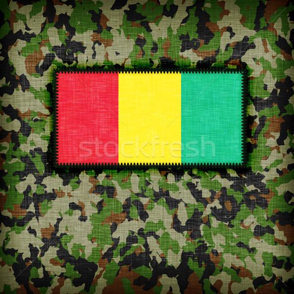 álca egyenruha Guinea zászló textúra absztrakt Stock fotó © michaklootwijk