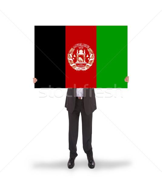 Işadamı büyük kart bayrak Afganistan Stok fotoğraf © michaklootwijk