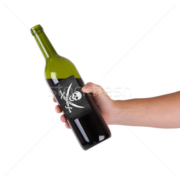 Mano botella vino tinto etiqueta pirata Foto stock © michaklootwijk