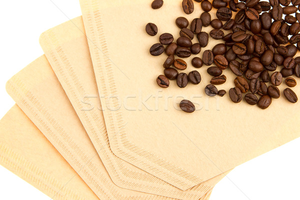 Coffee beans on a coffee filter (white background) Stock photo © michaklootwijk