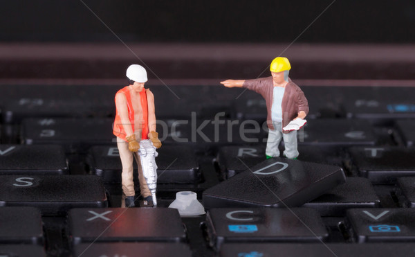 Miniature workers with drill working on keyboard Stock photo © michaklootwijk