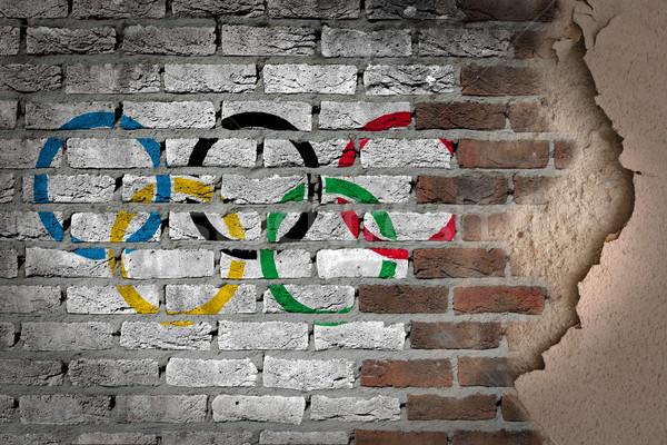 Dark brick wall with plaster - Olympic rings Stock photo © michaklootwijk