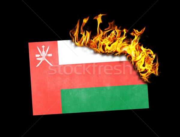 Zászló égő Omán háború válság tűz Stock fotó © michaklootwijk