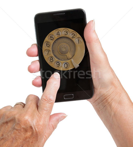 Senior woman hand with smart phone isolated, old fashion dial Stock photo © michaklootwijk