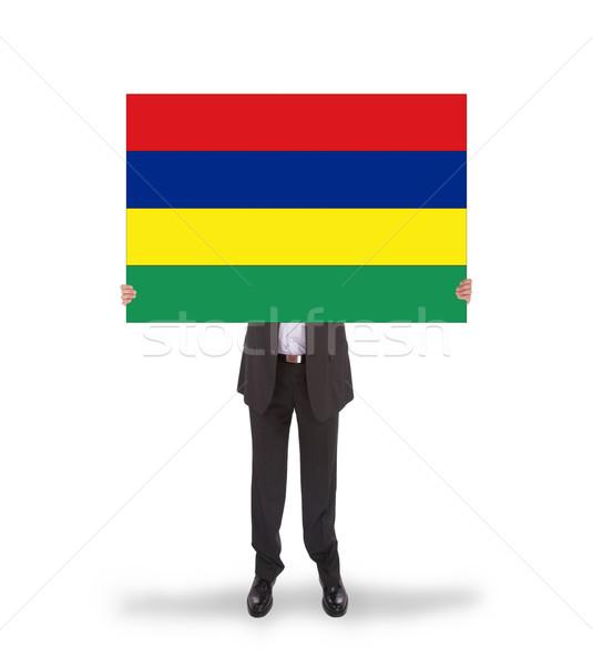 Businessman holding a big card Stock photo © michaklootwijk