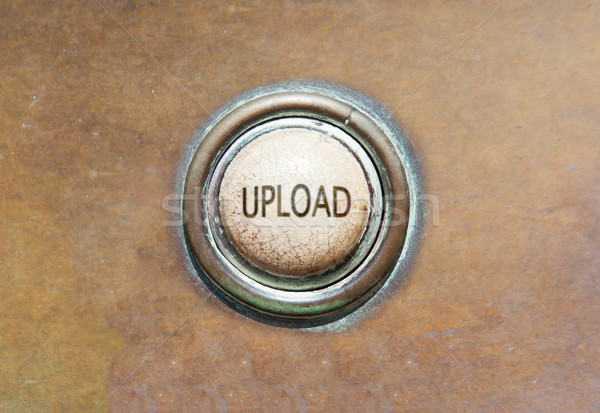 Old button - upload Stock photo © michaklootwijk